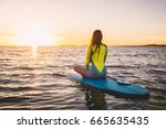 slim girl on stand up paddle... | Shutterstock . vector #665635435