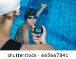 the instructor in the pool with ... | Shutterstock . vector #665667841