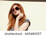 fashion woman posing with... | Shutterstock . vector #665684257