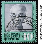 Small photo of MOSCOW, RUSSIA - APRIL 2, 2017: A post stamp printed in DDR (Germany) shows head of Egyptian princess Amarna, circa 1979