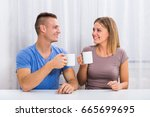 husband and wife drinking... | Shutterstock . vector #665699695