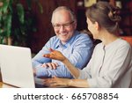 two smiling people discussing... | Shutterstock . vector #665708854