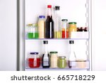 many different sauces in fridge | Shutterstock . vector #665718229