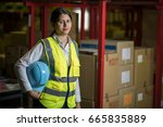 female warehouse worker with... | Shutterstock . vector #665835889