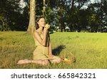 beautiful woman sitting on...   Shutterstock . vector #665842321