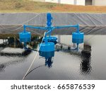 Small photo of Large aerator agitator used for wastewater treatment plant inside the factory.