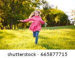 the girl run and play with soap ... | Shutterstock . vector #665877715
