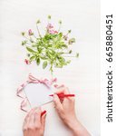 female hand write a greeting...   Shutterstock . vector #665880451