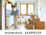 portrait of young couple moving ... | Shutterstock . vector #665890159