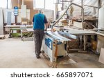 worker sawing wood panel saw... | Shutterstock . vector #665897071