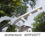 modern led streetlamp. energy... | Shutterstock . vector #665910277