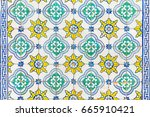 Small photo of Azulejos tiles on a wall in Lisbon. Decorative tiles typical in Spain and Portugal on exterior walls. Texture and background with arabesque style