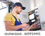 electrician measuring voltage... | Shutterstock . vector #665914441