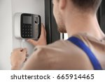 young electrician installing... | Shutterstock . vector #665914465