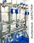 Small photo of Booster system with meters, pipes and filters on stand