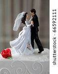 wedding cake and topper with... | Shutterstock . vector #66592111