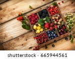 mix of fresh berries with... | Shutterstock . vector #665944561