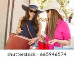 happy woman with shopping bags... | Shutterstock . vector #665946574