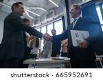businessmen handshake after... | Shutterstock . vector #665952691
