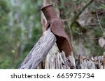rusty mattock in a wooden post. | Shutterstock . vector #665975734