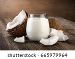coconut and a glass of coconut... | Shutterstock . vector #665979964
