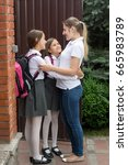 happy young mother hugging her... | Shutterstock . vector #665983789