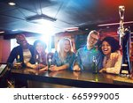 a group of friends inside the... | Shutterstock . vector #665999005