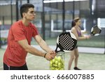 couple training paddle tennis... | Shutterstock . vector #666007885