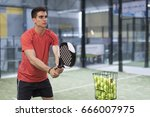 man training in paddle tennis... | Shutterstock . vector #666007975