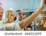 blond young woman putting... | Shutterstock . vector #666011695