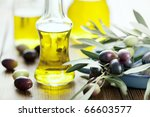 olive oil on wooden table | Shutterstock . vector #66603577
