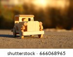 old wooden toy car on the road
