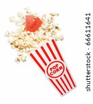 popcorn spilling out of a container, with two tickets - stock photo