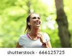 woman jogging in the forest | Shutterstock . vector #666125725