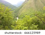 mountain green valley stream... | Shutterstock . vector #666125989