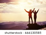 happy couple stands on mountain ... | Shutterstock . vector #666130585