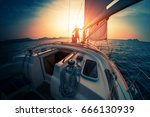 young couple enjoys sunset from ... | Shutterstock . vector #666130939