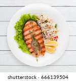 grilled salmon steak and... | Shutterstock . vector #666139504