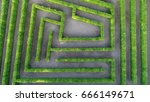 Small photo of Aerial photo low altitude above bush maze showing different paths just one leading to exit also known as labyrinth is path or collection of paths typically from entrance to goal drone top-down view