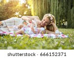 young mother and baby having a... | Shutterstock . vector #666152371