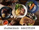 appetizing stake on wooden... | Shutterstock . vector #666155104