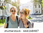 outdoor portrait of two female... | Shutterstock . vector #666168487