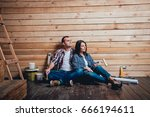 happy couple making repairs to... | Shutterstock . vector #666194611