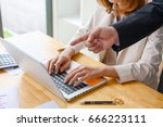 businessman pointing at a...   Shutterstock . vector #666223111