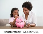 an african girl sitting with... | Shutterstock . vector #666254011