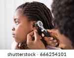 doctor using otoscope... | Shutterstock . vector #666254101