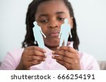 close up of sad girl holding... | Shutterstock . vector #666254191