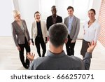 rear view of manager with his... | Shutterstock . vector #666257071
