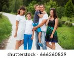 Small photo of Happy family the vacationer in park