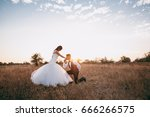 wedding couple on a walk | Shutterstock . vector #666266575